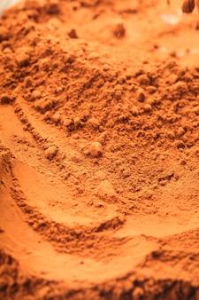 Шоколадный порошок крупным планом как фон