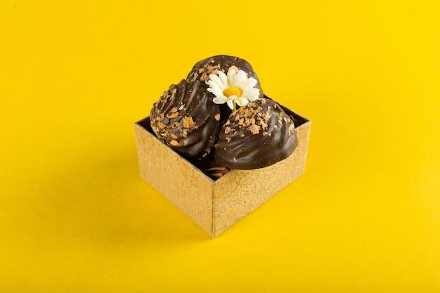 Chocolate pralines in a cardboard box