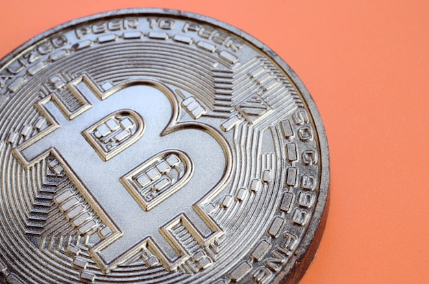 Chocolate product in the form of physical bitcoin. model of the crypto currency in the edible form