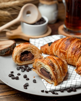 Chocolate puff pastry croissant sprinkled with chocolate chips