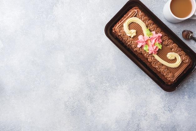 Chocolate rectangular cake decorated with cream roses