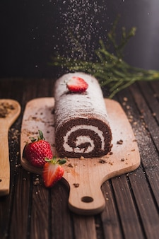 Chocolate roll decorating with strawberries