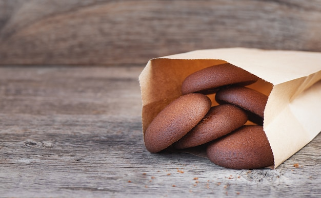 Chocolate round cookies on a wooden background
