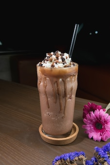 Chocolate shake in tall glass with dark background