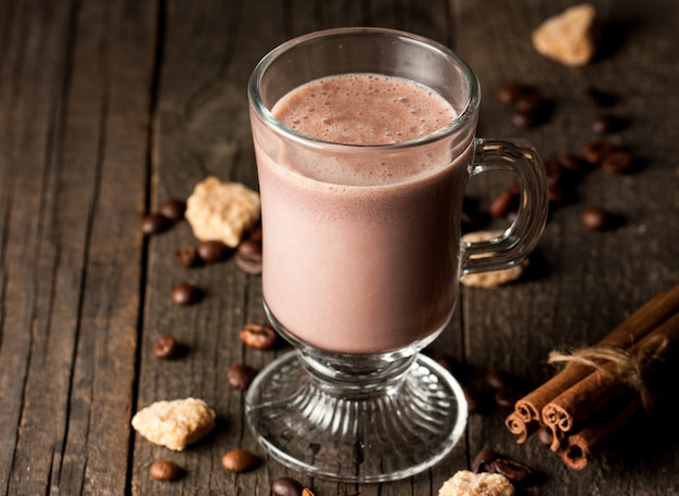 Chocolate shake on wooden background.