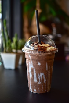 Chocolate smoothie with jar in cafe