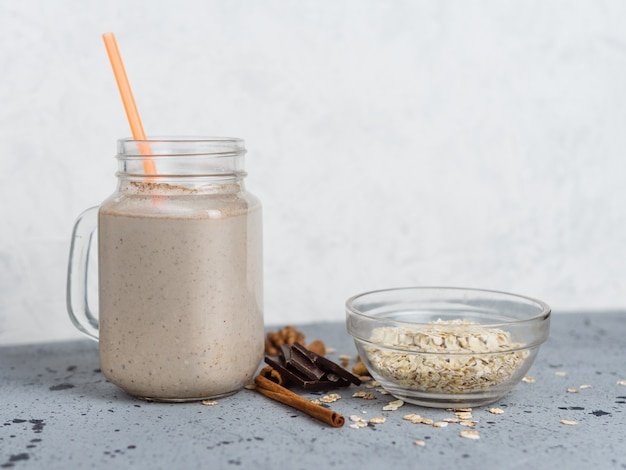 Chocolate smoothie with oatmeal and nuts in a jar