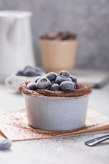 Chocolate souffle with frozen blueberry. french traditional dessert.