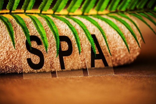 Chocolate spa, composition brown towel in hotel room of spa treatment,