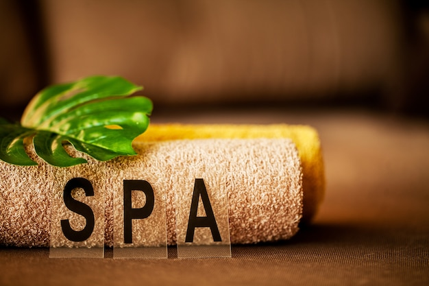 Chocolate spa, composition brown towel in hotel room of spa treatment