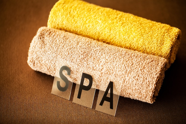 Chocolate spa. composition brown towel in hotel room of spa treatment.