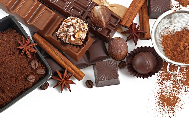 Chocolate and spices isolated on white