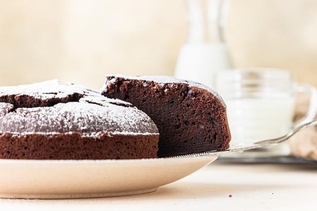 Chocolate sponge flourless cake with sugar powder