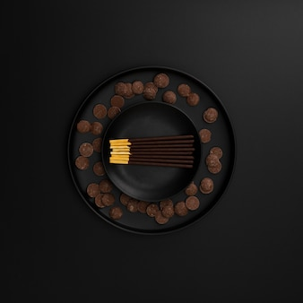 Chocolate sticks plate on a dark background