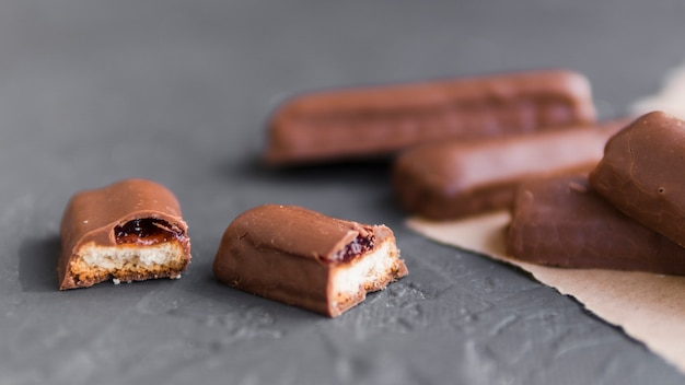 Chocolate sticks with biscuit and jelly stuffing