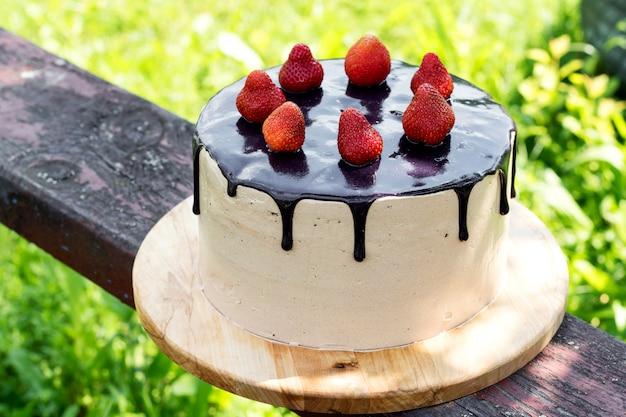 Chocolate summer cake with strawberries.
