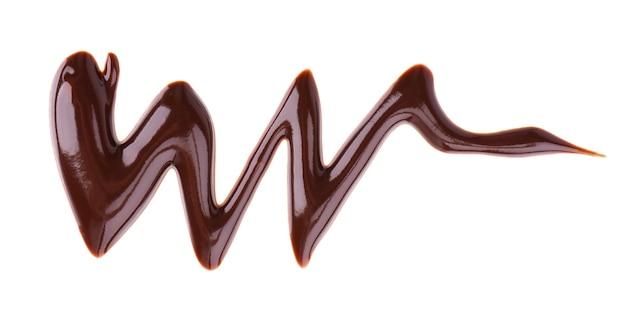 白に分離されたチョコレートシロップの小雨