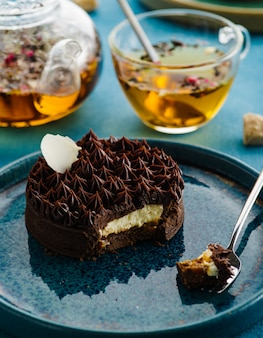 Chocolate tart with white filling. delicate chocolate dessert with flower tea.