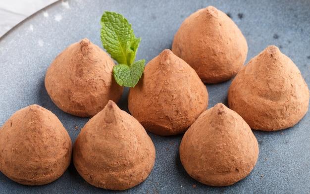 Chocolate truffle on blue ceramic plate.