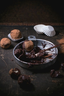 Chocolate truffles on concrete
