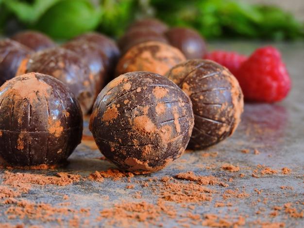 Chocolate truffles and fresh juicy raspberries
