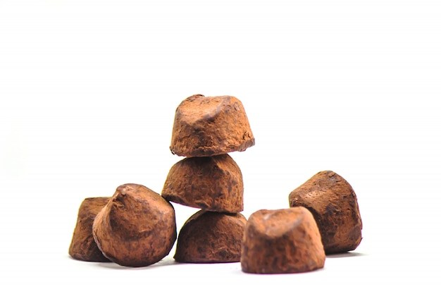 Chocolate truffles on white background. selective focus.