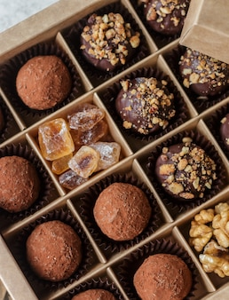 Chocolate truffles with nuts and cocoa