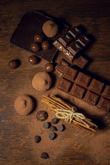 Chocolate and truffles on wooden background