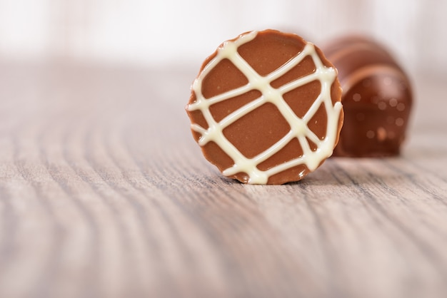 Chocolate truffles on a wooden surface