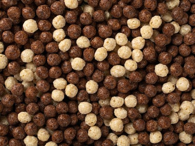 Chocolate vanilla breakfast cereal balls mix texture background.