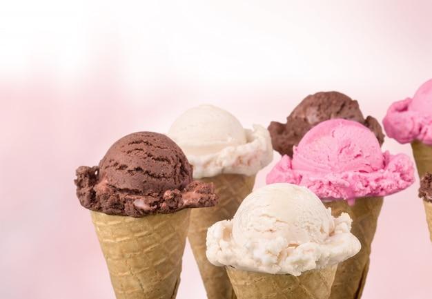 Chocolate, vanilla and strawberry ice cream in the cones