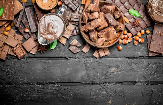 Chocolate. various assortment of chocolate with paste. on black rustic.