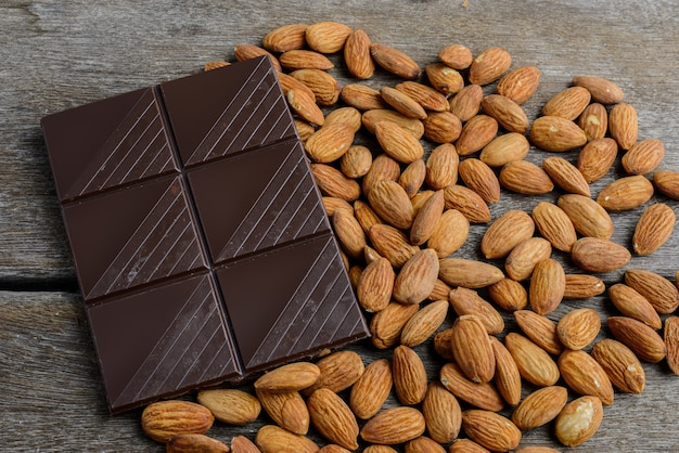 Chocolate with almond on wooden