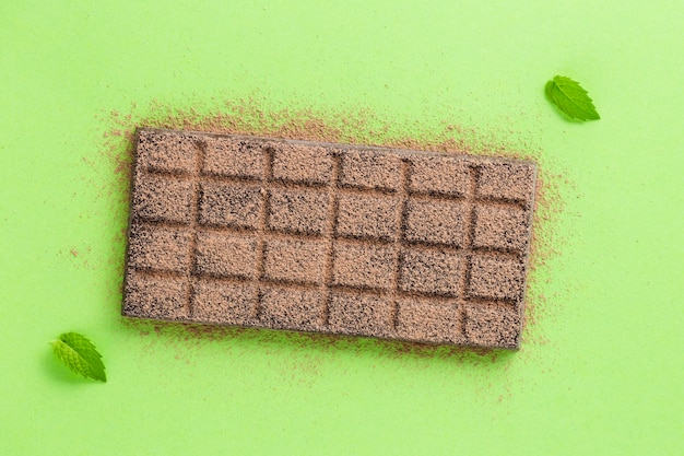 Chocolate with cocoa powder and leaves