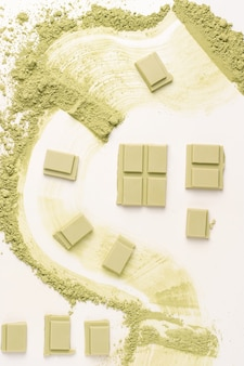 Chocolate with matcha tea on a white background. view from above