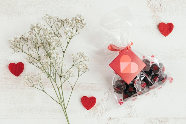 Chocolates bag with flowers and hearts