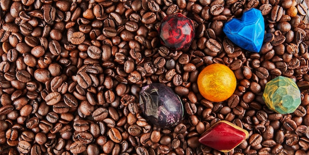 Chocolates in the form of precious stones on coffee beans