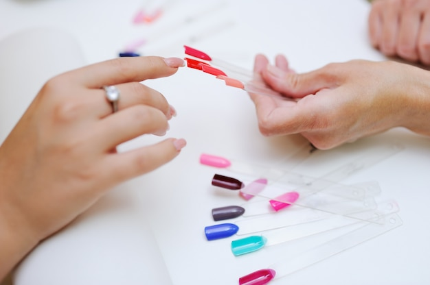 The choice of color nail polish in the beauty salon