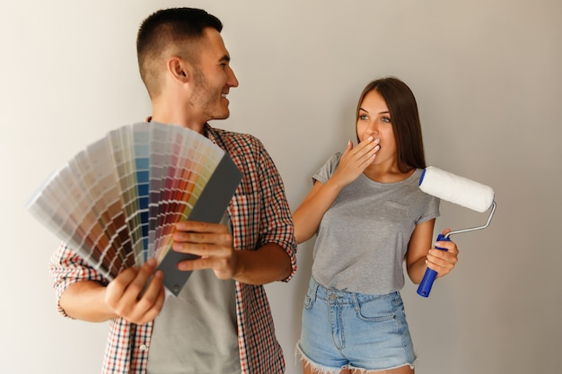 Choice of color for painting wall. couple with color palette and paint roller