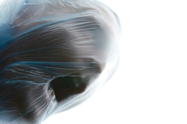 Choke. a man with blue transparent plastic bag over his head is suffocating. suffocation.