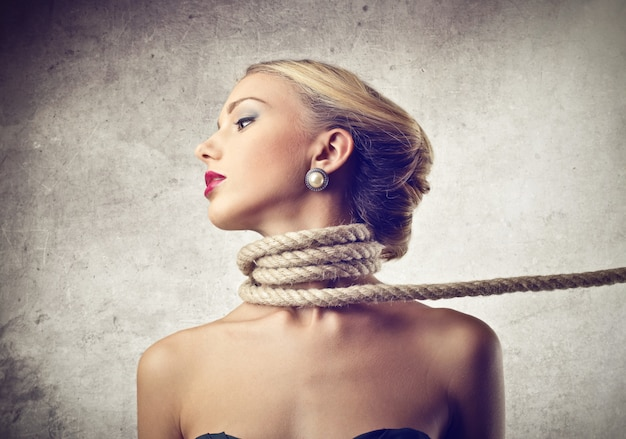 Choking a woman with a rope