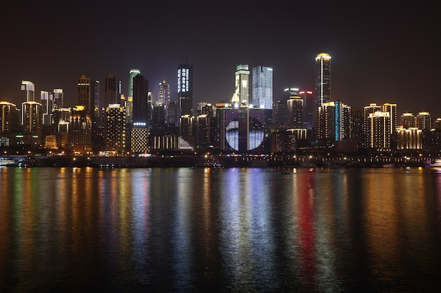 Chongqing, china, skyscraper, sky line tall building business city in night time, yangze river