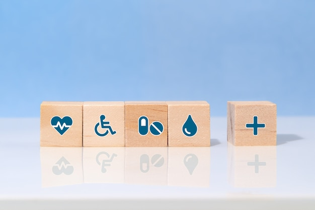 Choose a emoticon icons healthcare medical symbol on wooden block. healthcare and medical insurance concept