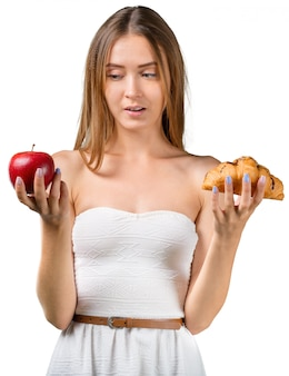 Choose, healthy food or not. attractive young woman
