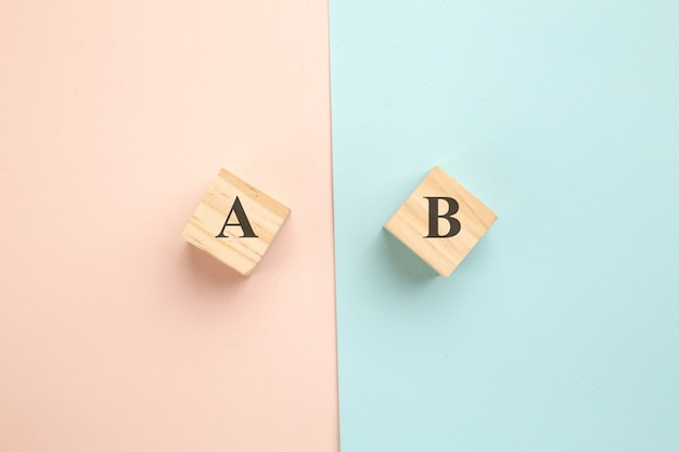 Choosing concept. a or b on wood blogs on colorful background.