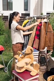 Choosing outer clothing at yard sale