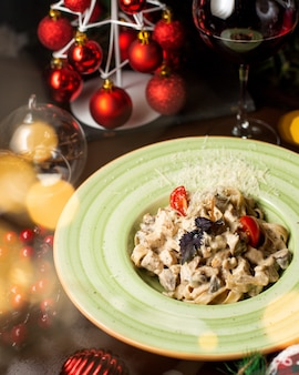 Chopped chicken breast with mushrooms, tomatoes and grated cheese on the top