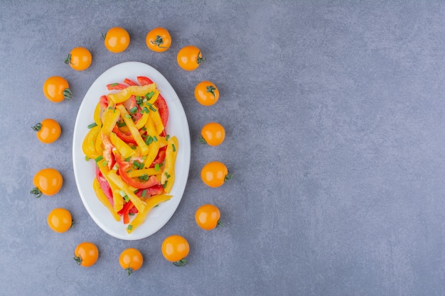 Chopped colorful bell pepper salad with cherry tomatoes aside