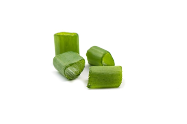 Chopped fresh green onions isolated on white wall.