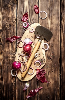 Chopped fresh onions on a wooden trunk. on wooden background.